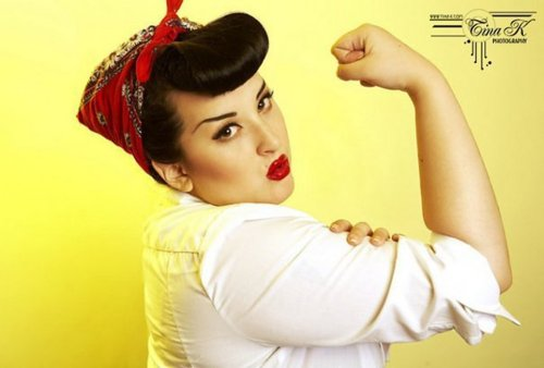 Model Kerosene Deluxe posing as Rosie the Riveter for photographer Tina Korhonen.