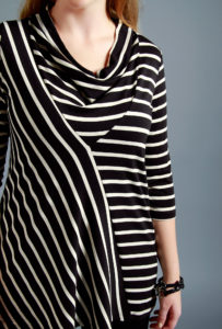 strengthtunic_blackcream_closeup