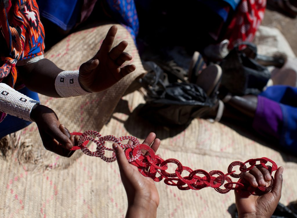 A community of Maasai women gather to craft their glass beaded jewelry