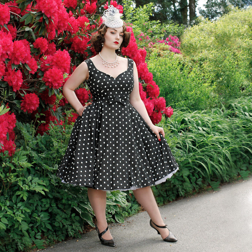 Kristen Meyn models a Cherry Velvet dress designed by Diane Kennedy and a hat by Maria Curcic